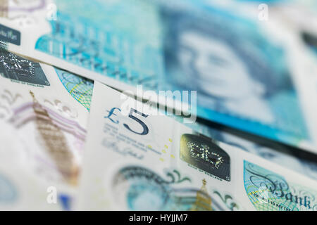 British Currency close up - pile of New Polymer Five Pound Notes, Sterling, Cash - Stock Photo