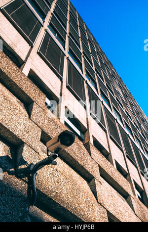 CCTV camera for surveillance on modern building facade, national security and government protection concept - Stock Photo