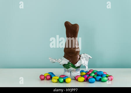 chocolate bunny for easter, against a blue background - Stock Photo