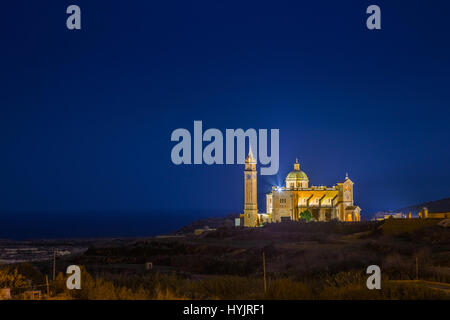 Gozo, Malta - The Basilica of the National Shrine of the Blessed Virgin of Ta' Pinu at night with clear starry sky - Stock Photo