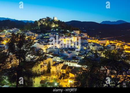 White village os Monda at dusk. Natural Park Sierra de las Nieves. Malaga province Costa del Sol. Andalusia Southern - Stock Photo