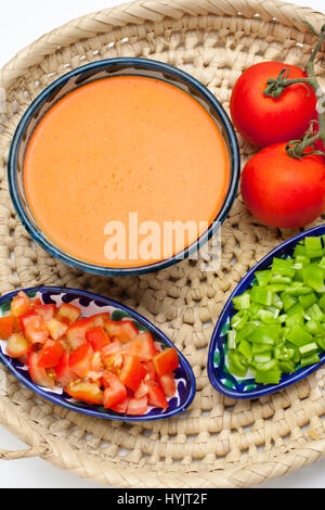 Food. Traditional Andalusian gazpacho with its ingredients. Tomato and green pepper. Andalusia, Spain. Europe - Stock Photo