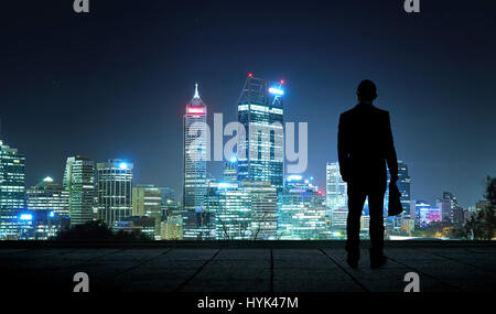 The silhouette portrait of businessman on the roof to see the scenery. Concept of vision of the future . - Stock Photo