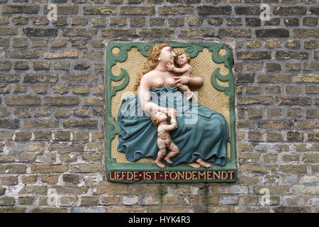 Traditional Gable stone 'Liefde Ist Fondemendt' (Love is the foundation), Gouda Museum, Gouda, Netherlands - Stock Photo