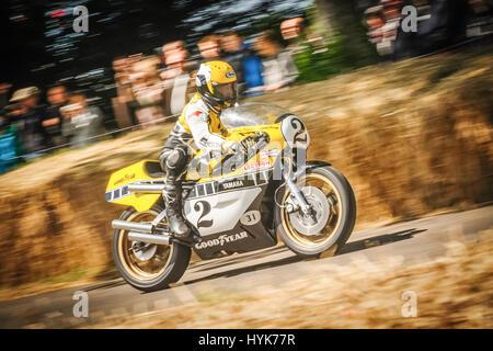 Goodwood, UK - July 1, 2012: Three-time 500cc motorcycle world champion Kenny Roberts on his classic Yamaha YZR500 - Stock Photo