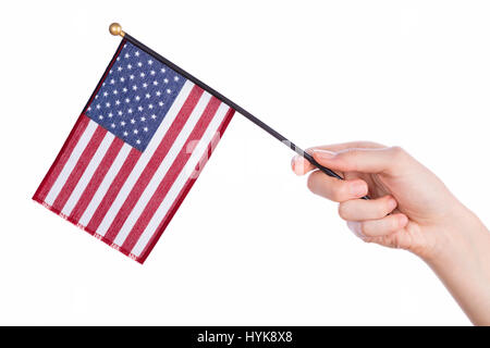 Hand holding american flag on white background - Stock Photo
