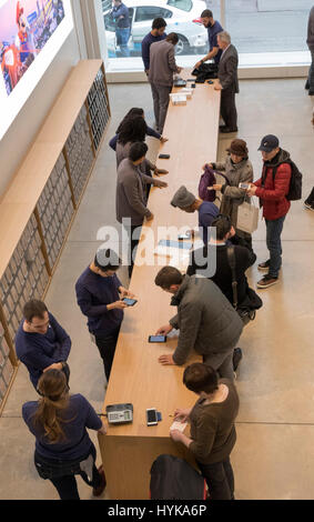 Customers at the Apple Store, Fifth Avenue, New York City, USA - Stock Photo