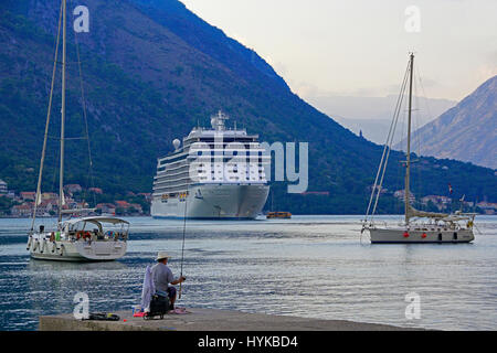 Bay of Kotor harbour with cruise ship in port - Stock Photo