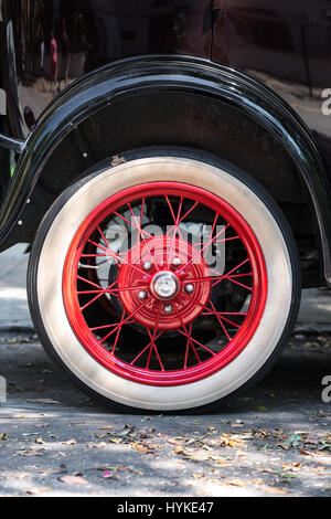 Close up of Black 1928 Ford Model A red wheel parked along the streets of Charleston, South Carolina on a summer - Stock Photo