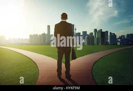 indecisive man and lost chooses the right path - Stock Photo