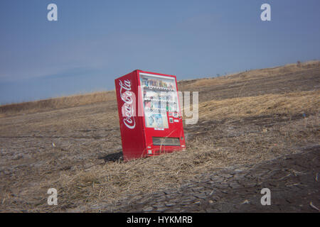 OTAMA VILLAGE, FUKUSHIMA: A vending machine is pictured in the middle of the landscape following the 2011 Tsunami. - Stock Photo