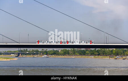 Tram mouving on Oberkasseler bridge in Dusseldorf - Stock Photo