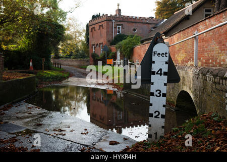 Ford crossing a road in the village of Grundisburgh, Suffolk, UK. - Stock Photo