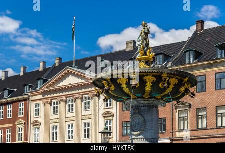 Caritas Fountain on Gammeltorv in Copenhagen, Denmark - Stock Photo