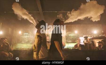 LONDON, UK: A pair of vapers breath out the gaseous plumes. LIFTING the lid on UK underground vaping culture these - Stock Photo