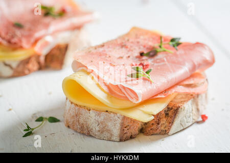 Crisp a piece of bread with cheese and ham - Stock Photo