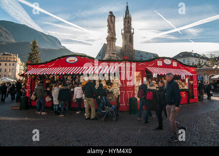 Visitors attend at the traditional Christmas markets of Bolzano, in Italy. - Stock Photo
