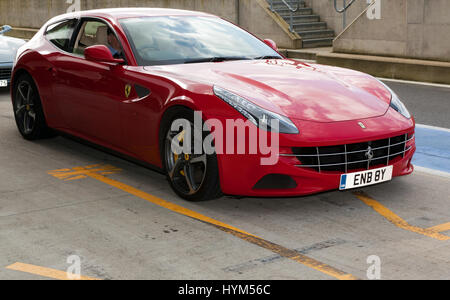 Three-quarter front view of a 2012,  Ferrari  FF, in the International Pit Lane  during the 2017 Silverstone Classic - Stock Photo