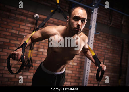 Male athlete working out with resistance bands - Stock Photo
