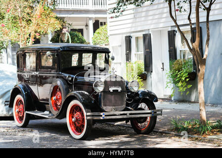 1928 Ford Model A parked along tree lined street in Charleston, South Carolina - Stock Photo