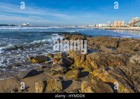 Rocky shore of Nevogilde civil parish of Porto, second largest city in Portugal. Port of Leixoes Cruise Terminal - Stock Photo