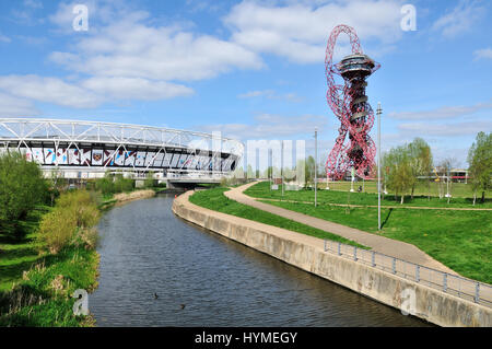 The London Stadium and City Mill River in the Queen Elizabeth Olympic Park at Stratford, East London UK - Stock Photo