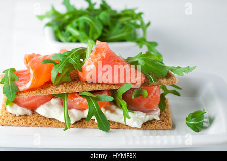 Canapes with smoked salmon cream cheese and basil stock for Smoked salmon cream cheese canape