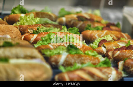 Beautifully decorated catering banquet table with different food snacks and appetizers with sandwich. - Stock Photo