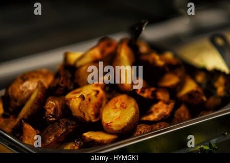 Fried Potatoes With Bacon And Onions In Pot Stock Photo