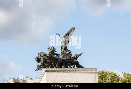 Wellington Arch, at Hyde Park Corner, in the West End of London, topped by a quadriga or ancient four-horse chariot - Stock Photo
