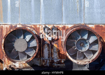 Abandoned venting fans on a chimney on an abandoned factory  Picture of an abandoned venting system rusted, on the - Stock Photo