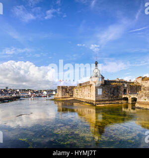 The main entrance of the old walled town or Ville Close of Concarneau in Brittany, France, with the port in the - Stock Photo