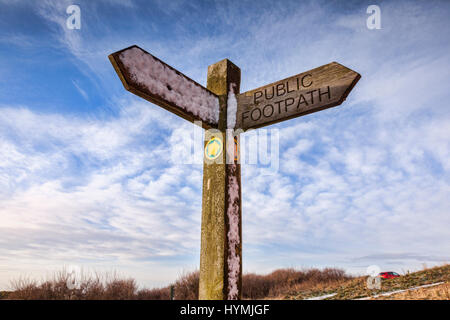 Public footpath sign with snow on it, at Flamborough Head, East Yorkshire, England, UK. - Stock Photo