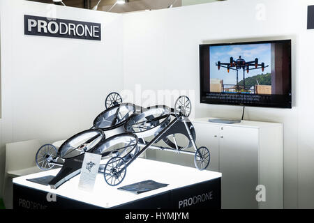 Prodrone company with dual robot arm large drone participating in exhibition fair Cebit 2017 in Hannover Messe, - Stock Photo
