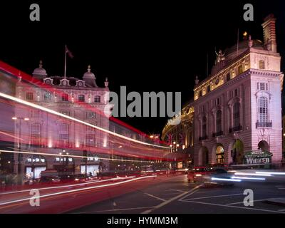 Road junction of Piccadilly Circus at nighttime in Central London, City of Westminister, England, United Kingdom - Stock Photo
