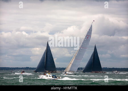J-Class yachts 'Lionheart' (H1), 'Ranger' (J5) and 'Rainbow' (H2) beating to windward in a stiff breeze during the - Stock Photo