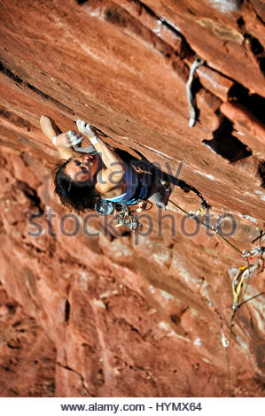 A woman climbs at the Fisher Towers in Castle Valley, Utah. - Stock Photo