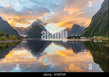 Mitre Peak reflecting in the water, sunset, Milford Sound, Fiordland National Park, Te Anau, Southland Region, Southland - Stock Photo