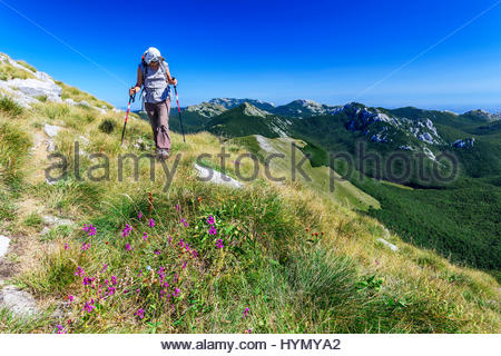 Woman hiking on mountain Velebit, Croatia - Stock Photo