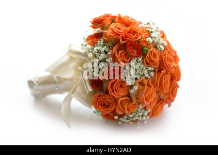 Wedding bouquet made of orange roses on white - Stock Photo