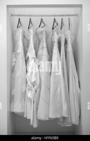 Collection of wedding dresses in the shop in black and white - Stock Photo