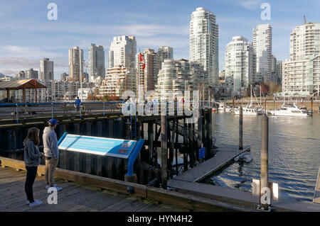 Granville island waterfront with False Creek and downtown condominium towers in back, Vancouver, British Columbia, - Stock Photo