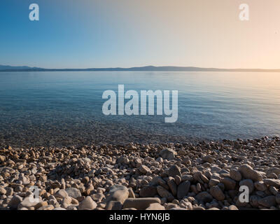 Beautiful day on empty pebble beach in Makarska, Croatia - Stock Photo