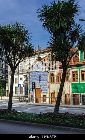Town houses and Senhor da Boa Nova Chapel on Rua de Dom Manuel II street in Porto city, second largest city in Portugal - Stock Photo