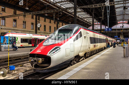 Basel, Switzerland - May 8, 2014: New Pendolino high-speed tilting train at Basel railway station. This train is - Stock Photo