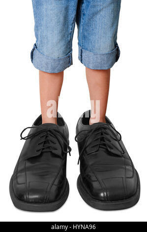 Little Boy in Big Shoes - Stock Photo