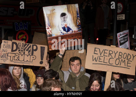 Cardiff, UK. 30th January 2017  Anti Trump Protesters stand with their signs at an Anti Trump demonstartion in Cardiff. - Stock Photo