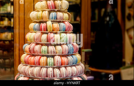 Round Macarons Cookies on the counter in the store - Stock Photo