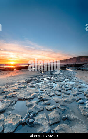 Beuatiful sunset over the beach at Dunraven Bay on the south coast of Wales - Stock Photo