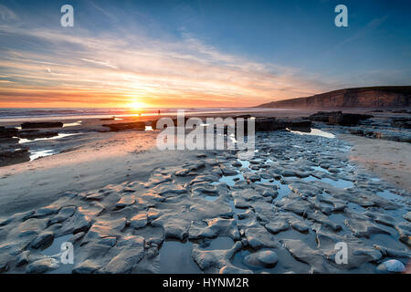 Sunset at Dunraven Bay a large beach at Southerndown on the south coast of Wales - Stock Photo